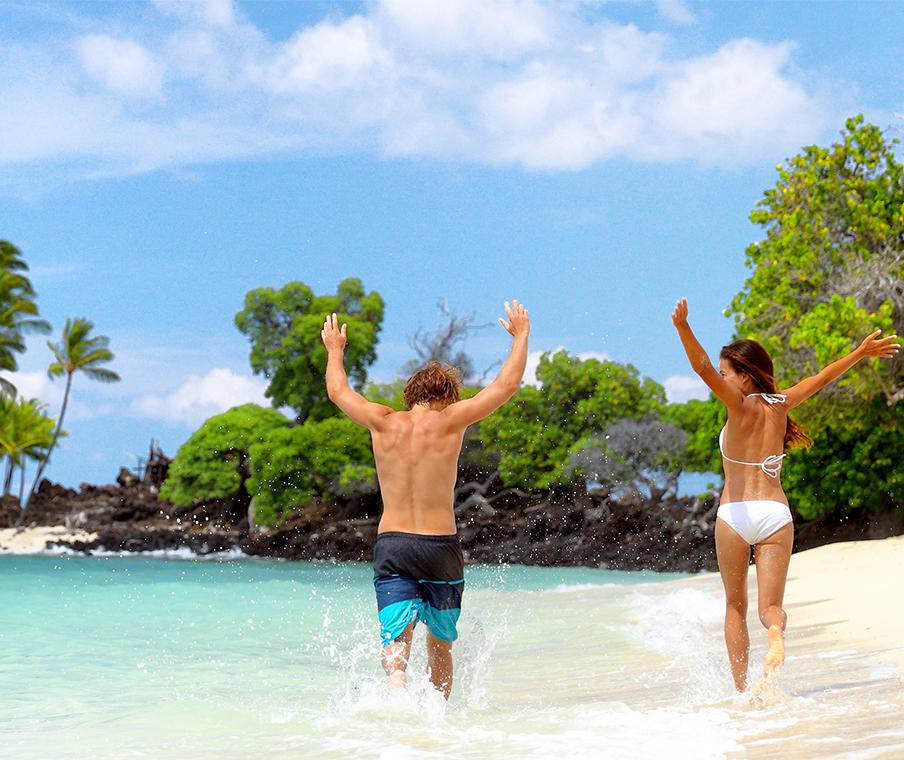 Couple running happily on beach