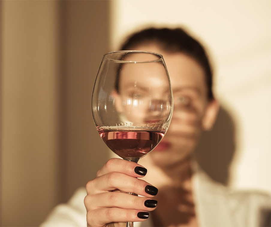 holding up glasses of cabernet