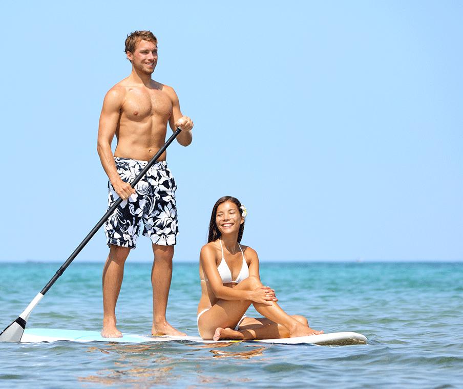 Couple paddle boarding
