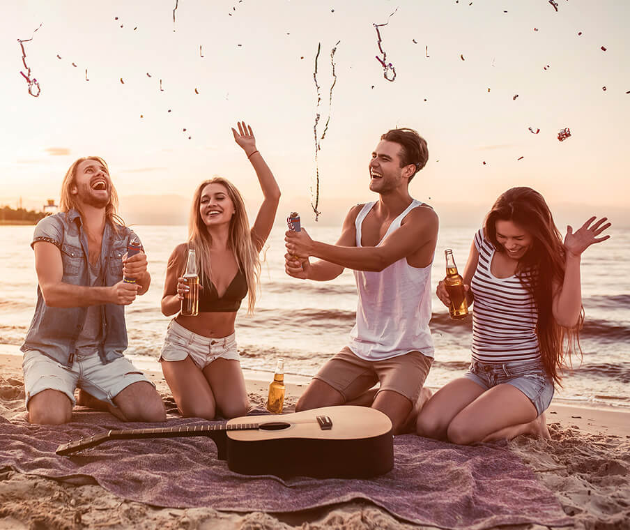 Friends with guitar on beach