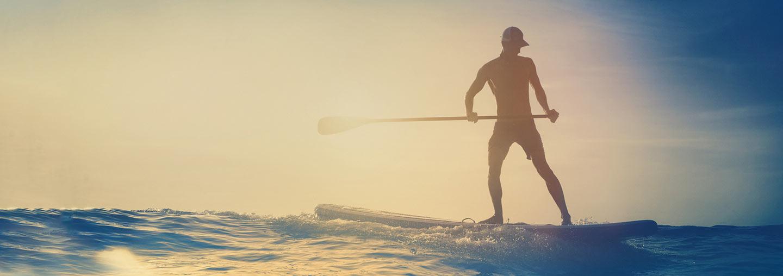 Man Paddleboarding On Ocean