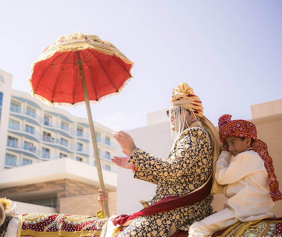 Man and boy on Elephant for Wedding