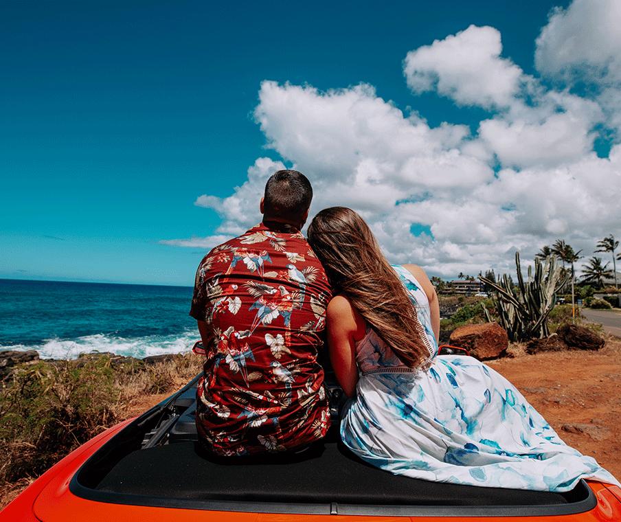 Couple walking on Poipu beach