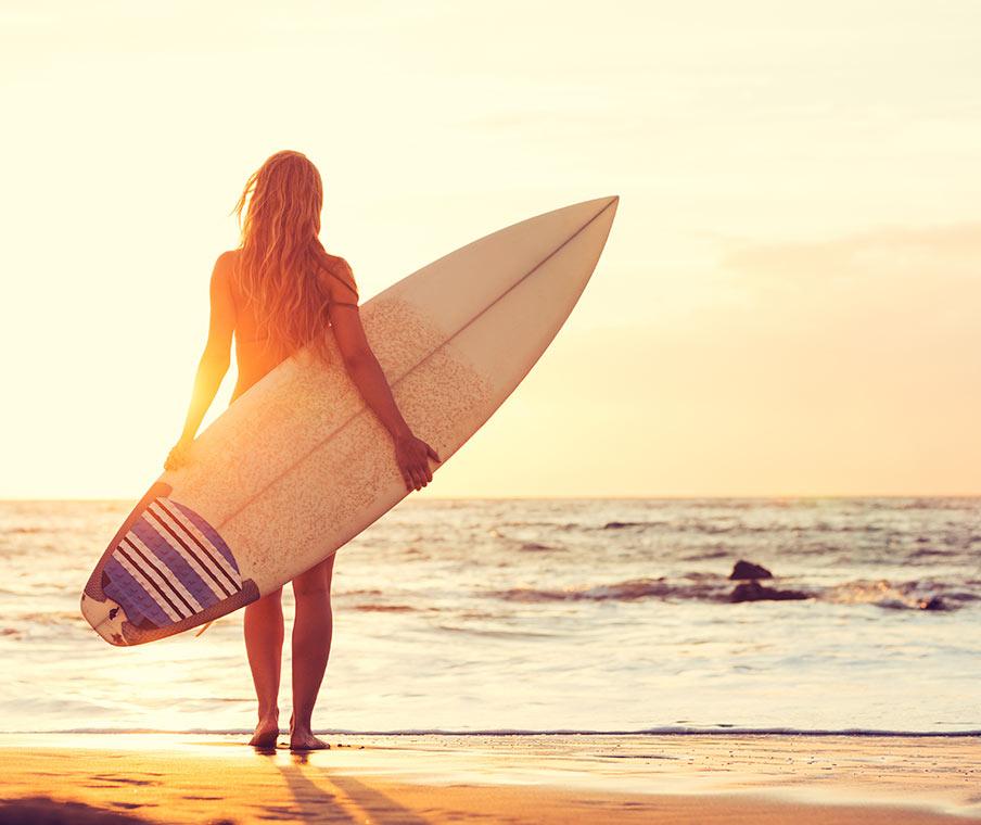Woman Surfing On Beach