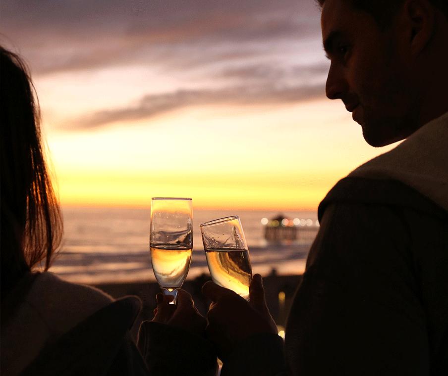 Honeymoon couple watching the sunset