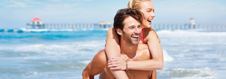 Couple On Beach Near Pier